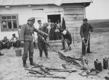an-ss-officer-supervises-the-destruction-of-weapons-captured-during-anti-partisan-operations-on-the-eastern-front-1941